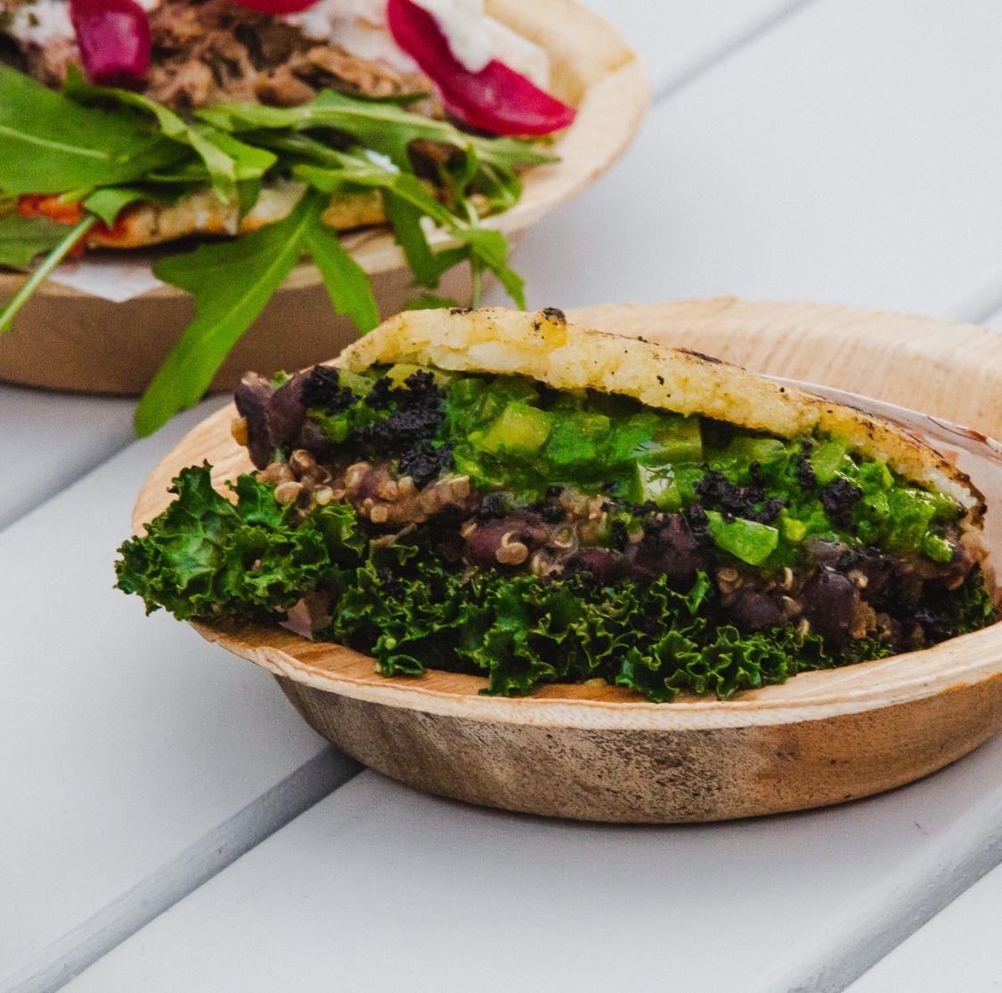 Mar and Tierra vegetarian arepas - Avocado, grilled kale, quinoa, beans
