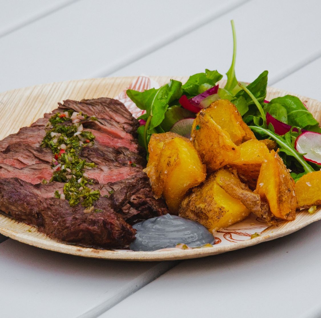 Mar and Tierra Grilled Steak - Chef's beef selection, crunchy potatoes and fresh greens