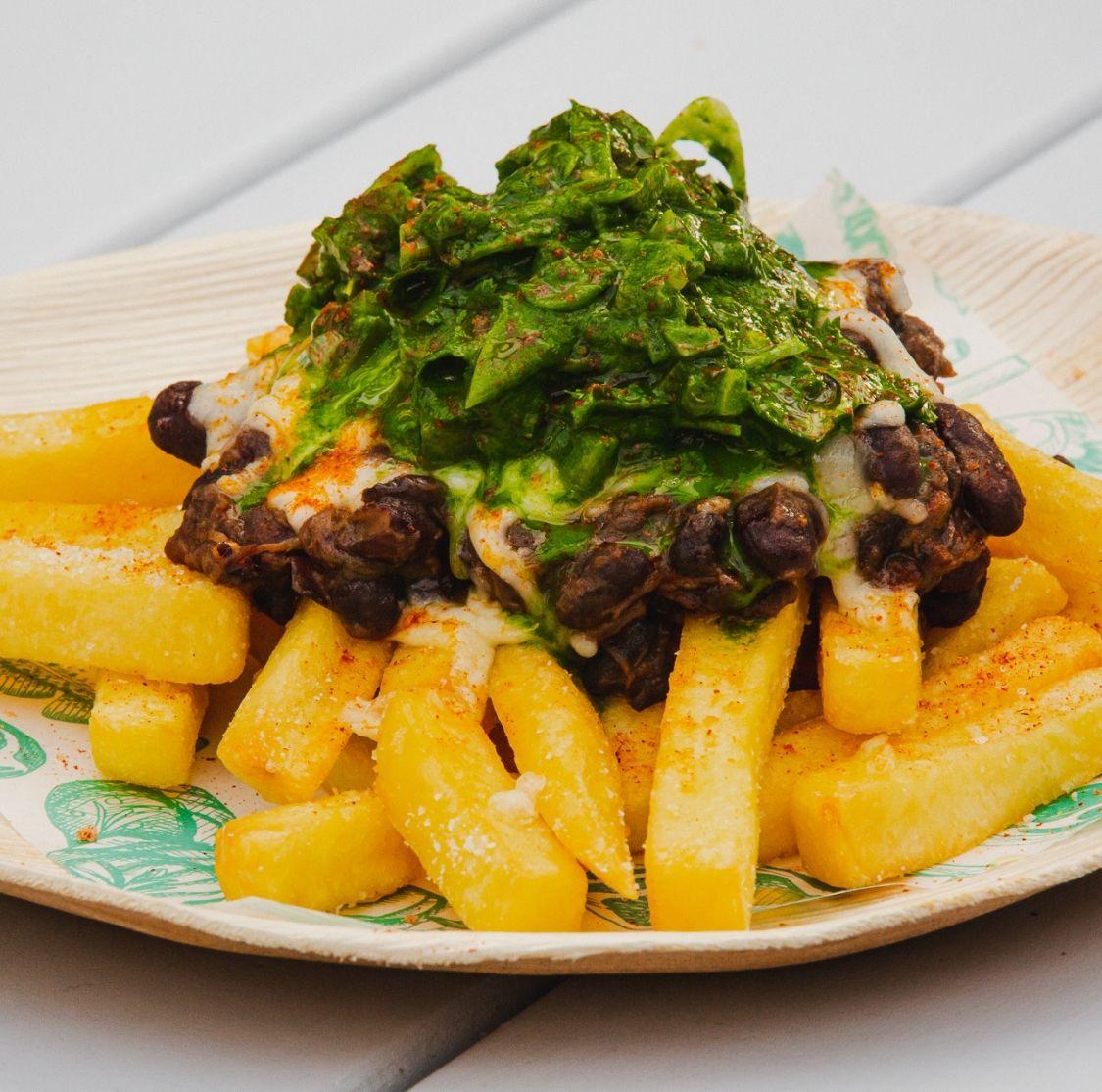 Mar and Tierra Loaded Fries - Beef brisket, mozzarella, green Criolla