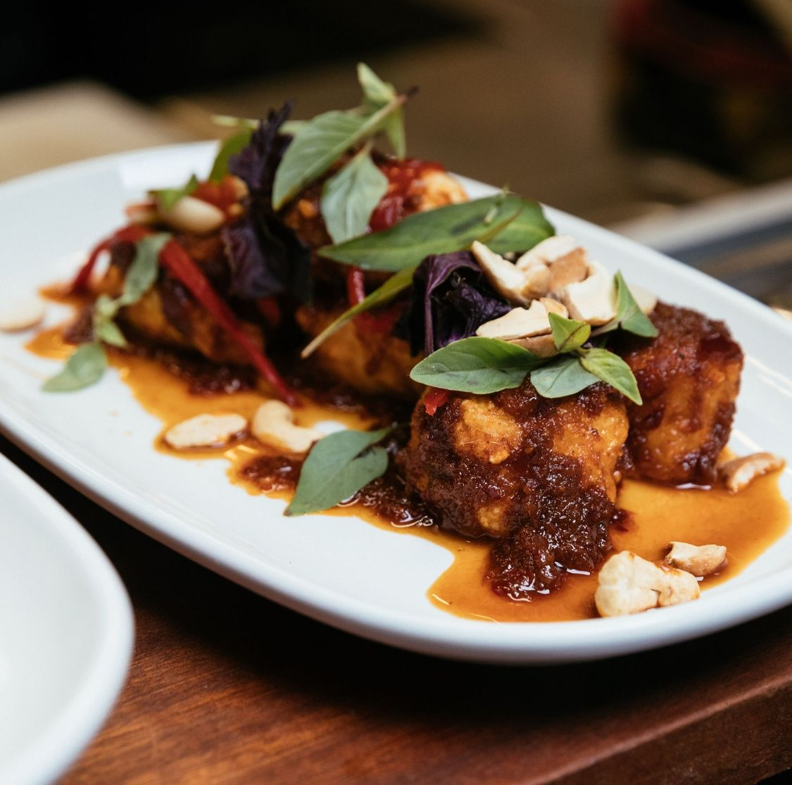 Tiki Thai CRISPY HAPUKA - Dry Red Curry, Cashew, Herbs, Pickled Chilli